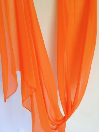 Orange-carot color in a ethereal chiffon scarf primed for you who search for an exceptional and delicate gift for a unique occasion and for your beloved ones.