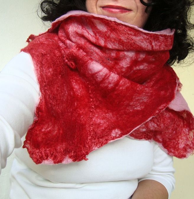 cobweb felted scarf -candy crushed- cobweb felted scarf -candy crushed- cobweb felted scarf -candy crushed- cobweb felted scarf -candy crushed- cobweb felted scarf -candy crushed- 🔎zoom  Request a custom order and have something made just for you. Item details 1 out of 5 stars.      (31) reviews Shipping & Policies This breezy and loose scarf is hand-felted with the cobweb felting technique especially for you who look for an exceptional and silky-smooth gift for a unique occasion and for your beloved ones. Make your unique moments handmade!  The scarf is made with the cobweb felt technique, thus some of its parts are transparent with some small holes. This is the fascinating part of the cobweb felt which makes it unique.  For the scarf is used extra-fine merino wool (18 mic) from Australia and New Zealand in red and pink colors. Additionally a large quantity of mulberry silk threads again in red are used in order to offer a shiny effect which adopts different hues depending on the natural light. The scarf is double-felted and has similar pattern on both sides.  It measures approximately 190 cm (74.8 in) length and 27-45 cm (10.6-17.7 in) width. This scarf's edges are wide giving the impression of a butterfly!  Although made of wool it is soft and airy and it feels absolutely like silk!  As all scarves made by QaraQul are a unique piece!  Thank you for stopping by!  Want to experience more felted accessories? Here you are: http://www.etsy.com/shop/QaraQul Meet the owner of QaraQul Learn more about the shop and process  Katerina cobweb felted scarf -candy crushed-